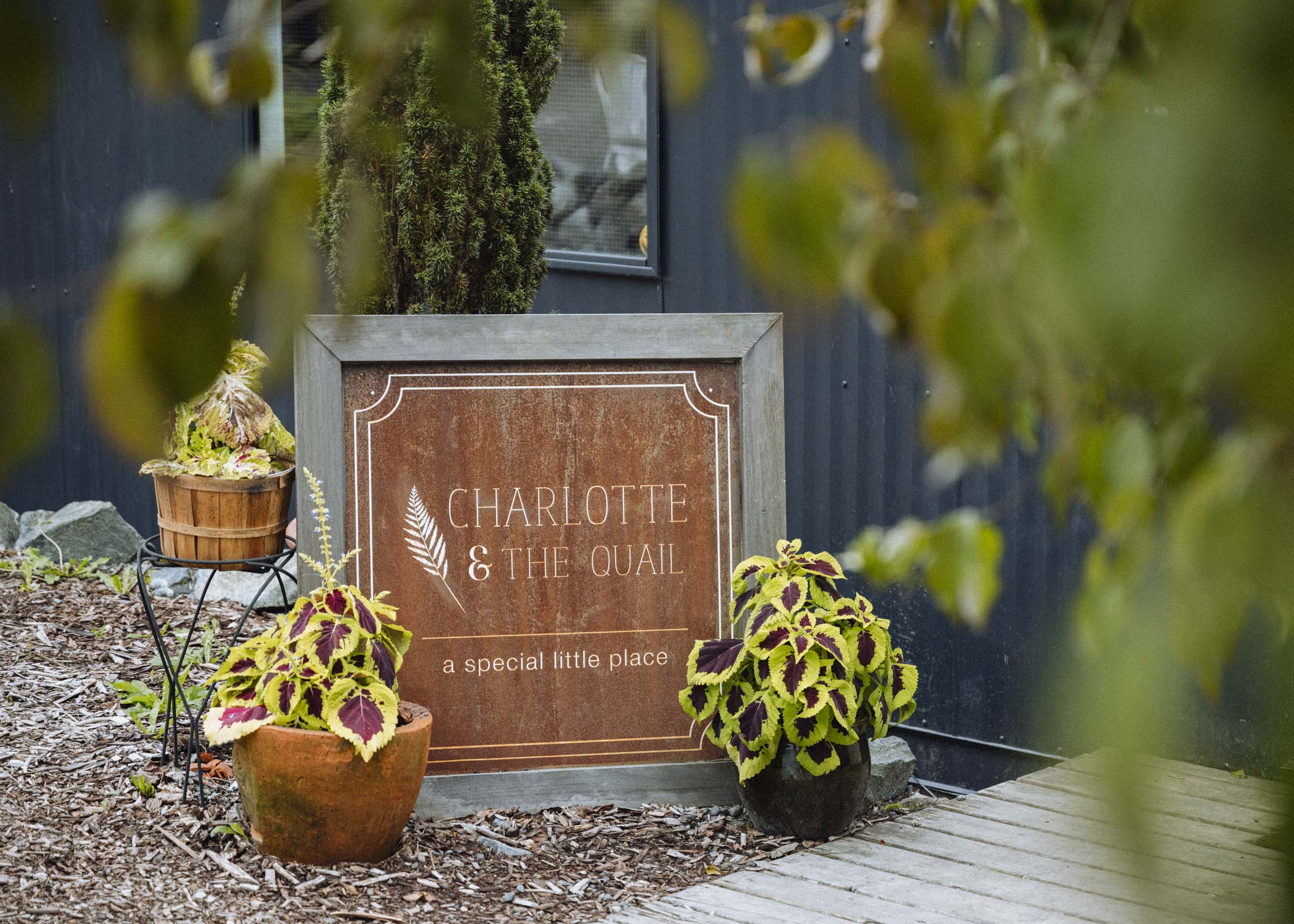 The entrance to Charlotte & the Quail, a cozy little restaurant cafe north of Victoria, BC
